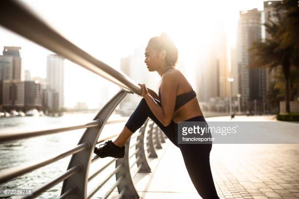 fitness woman stretching in dubai marina