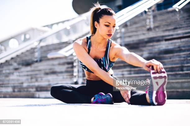 fitness woman stretching on the steps