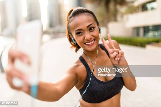 Fitness Woman take a selfie in Dubai Marina