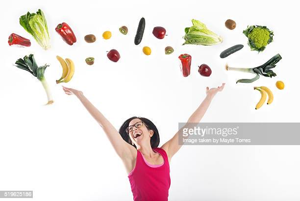 Fitness woman with vegetables on the air