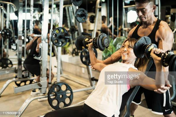 fitness woman working out at private gym - 練習 ストックフォトと画像