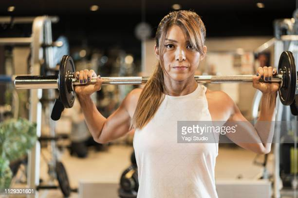 fitness woman working out at private gym - female bodybuilder stock pictures, royalty-free photos & images