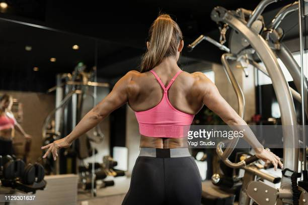 fitness woman working out at private gym - bodybuilding stock-fotos und bilder