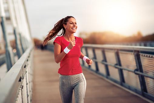 Fitness women exercising outdoors 1179767135
