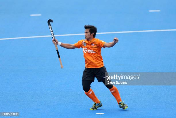 Fitri Saari of Malaysia celebrates scoring their teams first goal during the semifinal match between Argentina and Malaysia on day eight of the Hero...