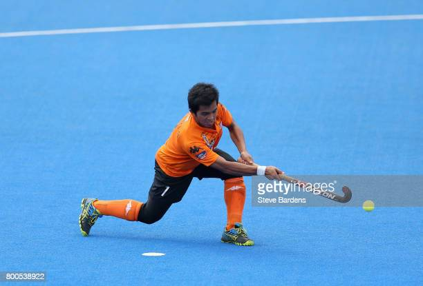 Fitri Saari of Malaysia scores their teams first goal from the penalty spot during the semifinal match between Argentina and Malaysia on day eight of...