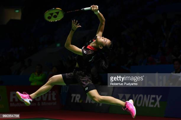 Fitriani of Indonesia competes against Ratchanok Intanon of Thailand during Women's Singles Round 1 on day one of the Blibli Indonesia Open at Istora...
