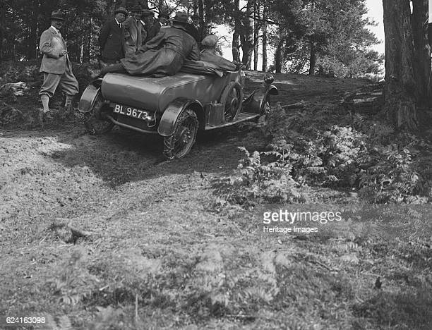 GWK fitted with tyre chains at a demonstration event Frensham Common Surrey 1922 Artist Bill BrunellGWK 2seater 1370 cc Vehicle Reg No BL9673 Driver...