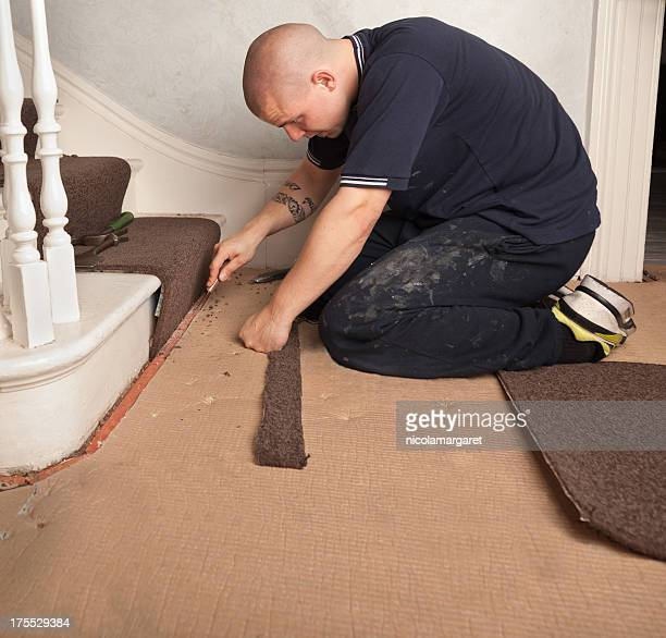 Fitter trimming stair carpet