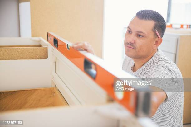 fitting a kitchen - customized stock pictures, royalty-free photos & images