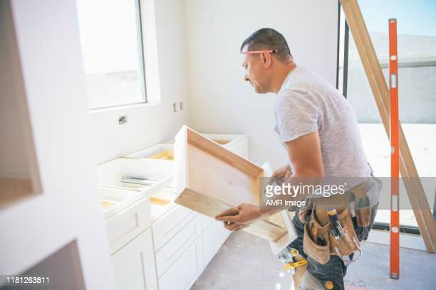 fitting a kitchen - domestic kitchen stock pictures, royalty-free photos & images