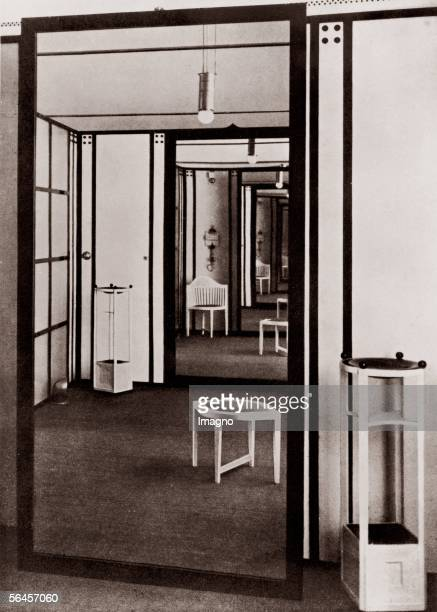 Fitting rooms in the fashion house of the Floege sisters designed by Josef Hofmann and Kolo Moser stool Jardiniere armchair mirror Photography 1904...