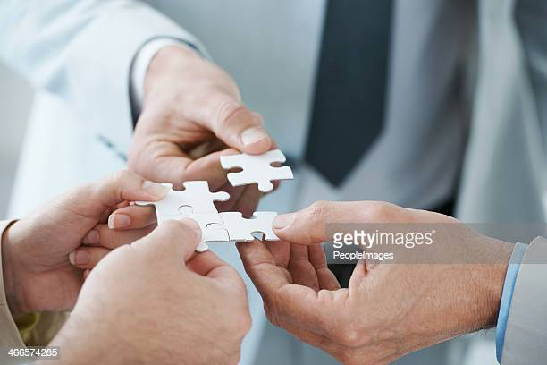 fitting the pieces together - raadsel stockfoto's en -beelden