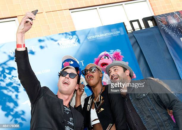 Fitz And The Tantrums band members Michael Fitzpatrick, Noelle Scaggs and James King take a selfie with Grover and Abby Cadabby at the 14th Annual...