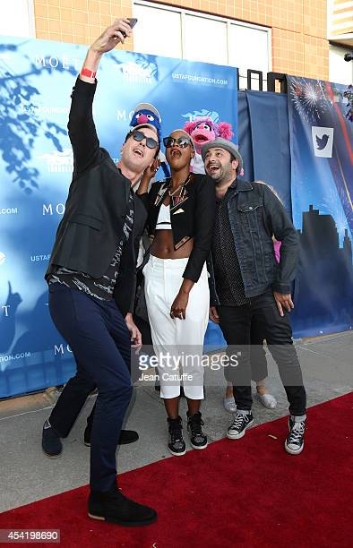 Fitz And The Tantrums band members Michael Fitzpatrick, Noelle Scaggs and James King take a selfie with Grover and Abby Cadabby at the 2014 US Open's...