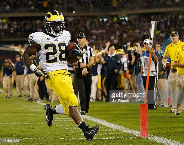 Fitzgerald Toussaint of the Michigan Wolverines scores a touchdown in the 4th quarter against the Connecticut Huskies at Rentschler Field on...