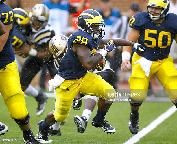 Fitzgerald Toussaint of the Michigan Wolverines takes off for a third quarter run while playing the Western Michigan Broncos at Michigan Stadium on...