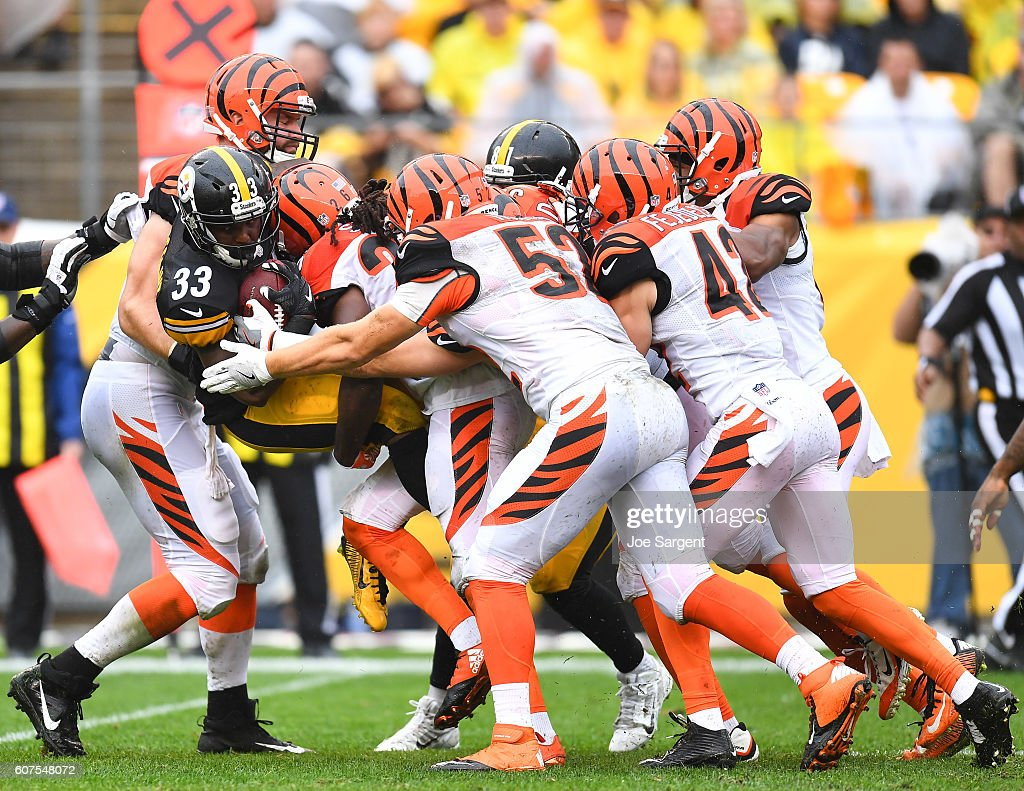 Fitzgerald Toussaint #33 of the Pittsburgh Steelers is gang tackled by the Cincinnati Bengals defense in the first quarter during the game at Heinz Field on September 18, 2016 in Pittsburgh, Pennsylvania.
