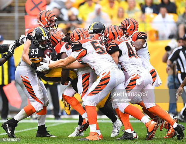 Fitzgerald Toussaint of the Pittsburgh Steelers is gang tackled by the Cincinnati Bengals defense in the first quarter during the game at Heinz Field...
