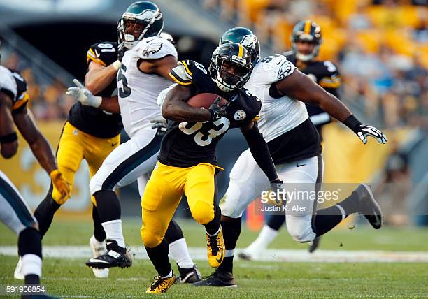 Fitzgerald Toussaint of the Pittsburgh Steelers rushes against the Philadelphia Eagles during a preseason game on August 18 2016 at Heinz Field in...