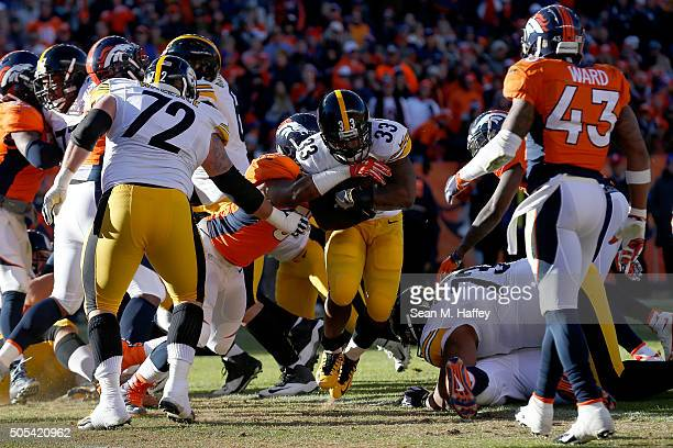 Fitzgerald Toussaint of the Pittsburgh Steelers scores a one yard touchdown in the first quarter against the Denver Broncos during the AFC Divisional...