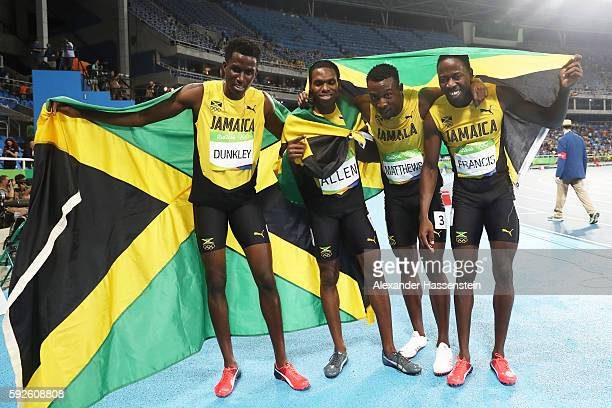 Fitzroy Dunkley Naton Allen Peter Matthews and Javon Francis of Jamaica react after winning silver during the Men's 4 x 400 meter Relay on Day 15 of...