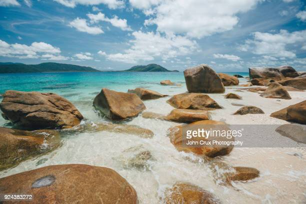 fitzroy island nudie beach - nudie stock pictures, royalty-free photos & images