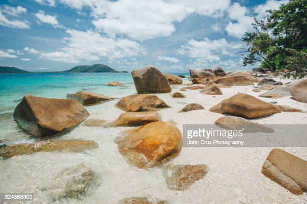 fitzroy island nudie beach rocks - nudie stock pictures, royalty-free photos & images