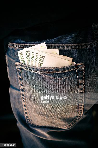 five 100 Euro notes in back pocket of a blue jeans