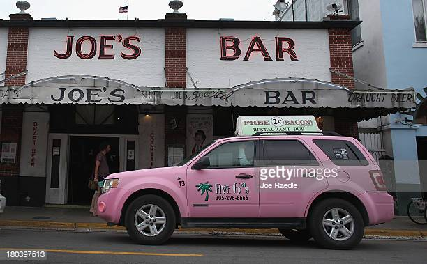 Five 6's Taxi drives past Sloppy Joe's Bar on Duval Street on September 12 2013 in Key West Florida The city recently enacted a Key West City...