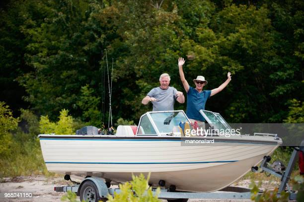 five active seniors brothers on a fishing trip - land vehicle stock pictures, royalty-free photos & images