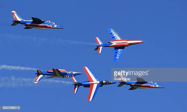 Five aircraft from the French Patrouille de France aerobatic group perform over England.
