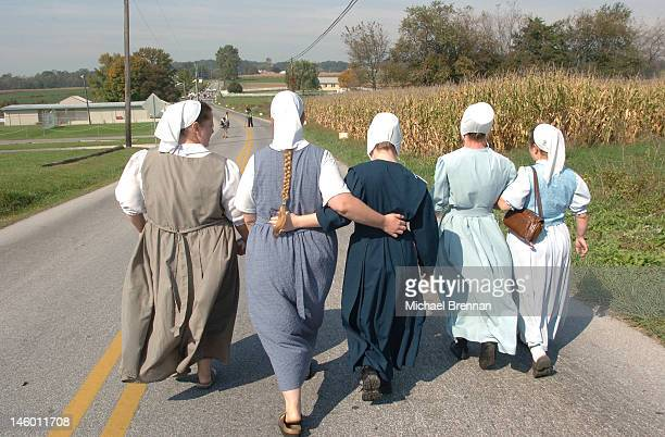 Five Amish women on their way to pray outside the schoolhouse in Nickel Mines Pennsylvania where several schoolchildren were recently murdered 5th...