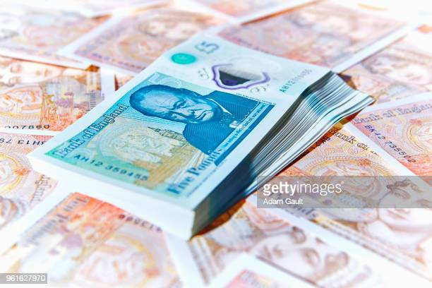 uk five and ten pound notes - ten pound note stock photos and pictures
