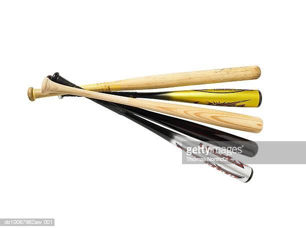 Five baseball bats on white background