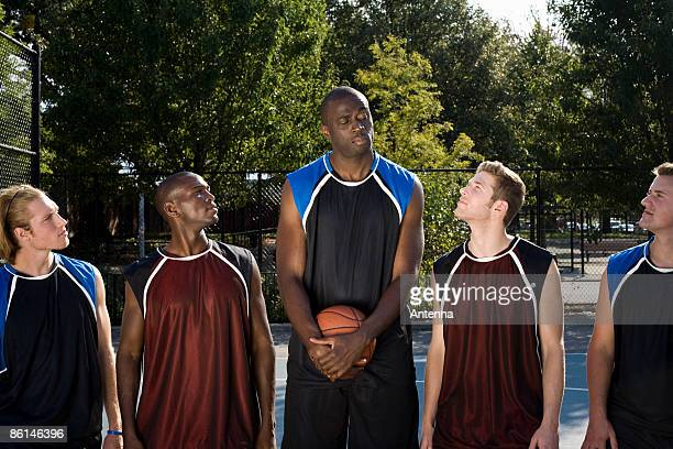 Five basketball players in a line