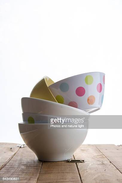 Five bowls stacked on a white table