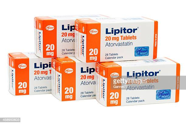 five boxes of atorvastatin (lipitor) tablets isolated on white. - pfizer stock pictures, royalty-free photos & images