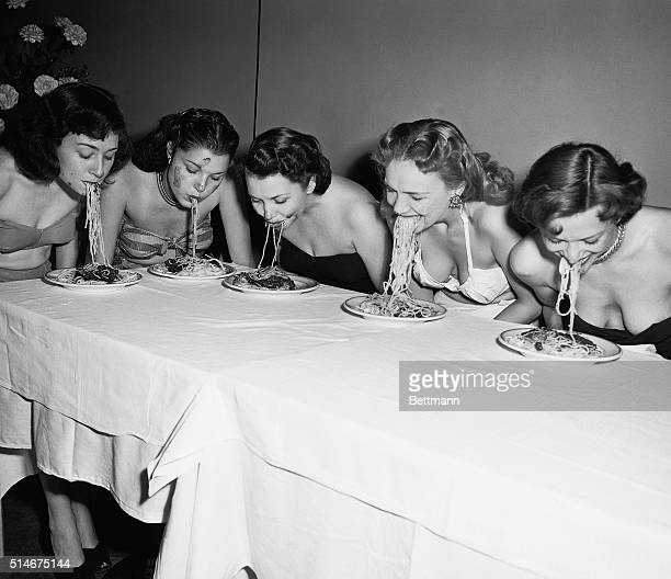 Five Broadway show girls participated in a 'Spaghetti Swooshing' contest They had to eat a plate of spaghetti and sauce without using their hands