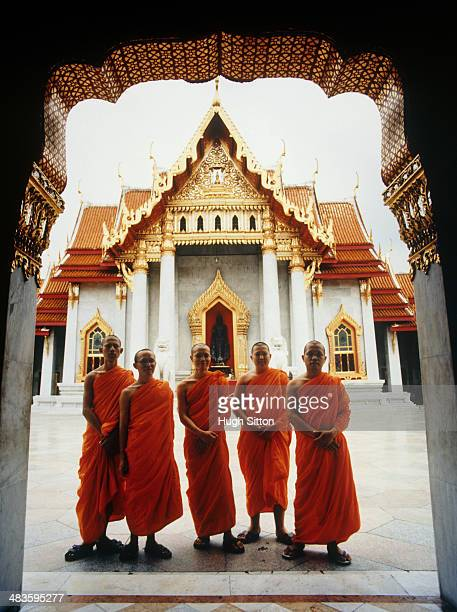 five buddhist monks at temple - wat benchamabophit stock photos and pictures