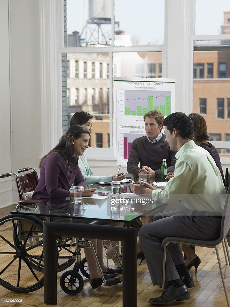 Five Business Executives In a Conference Room Meeting : Stock Photo