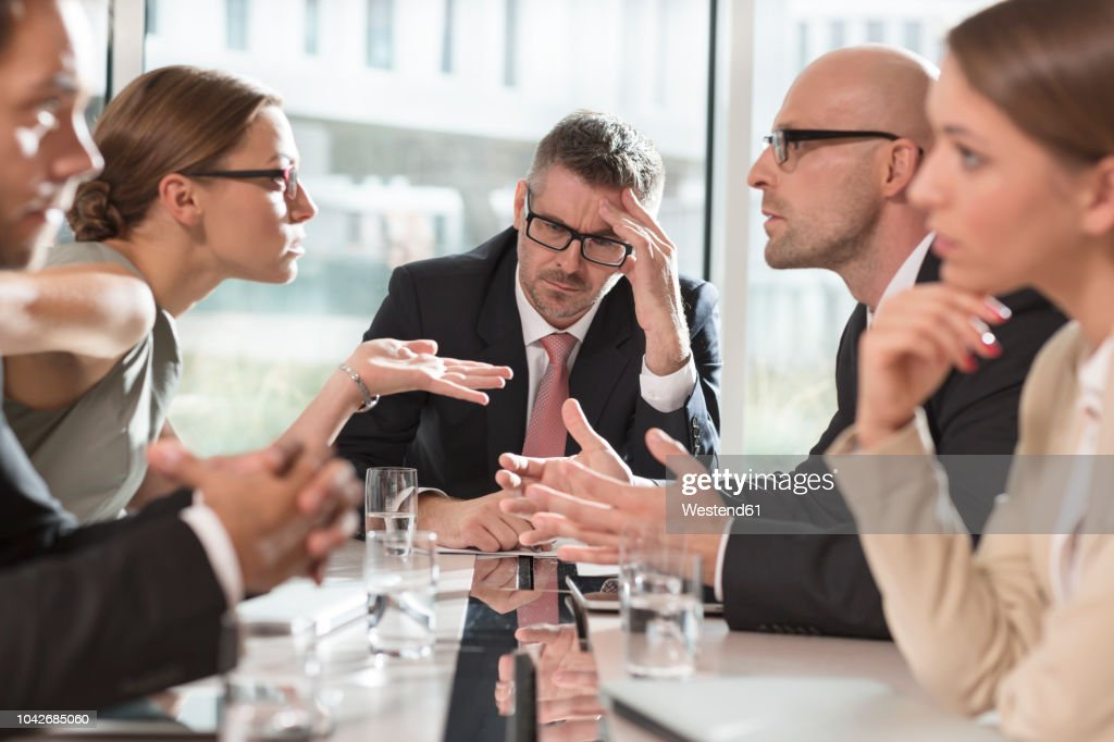 Five business people having an argument : Stock Photo