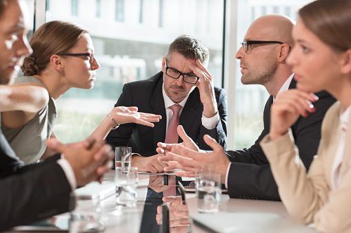 Five business people having an argument - gettyimageskorea
