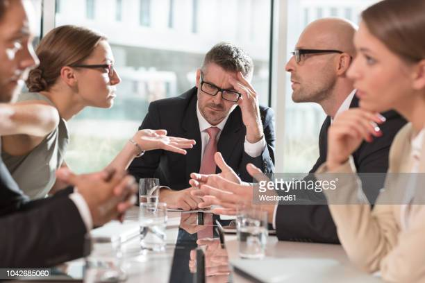 five business people having an argument - stress stock-fotos und bilder