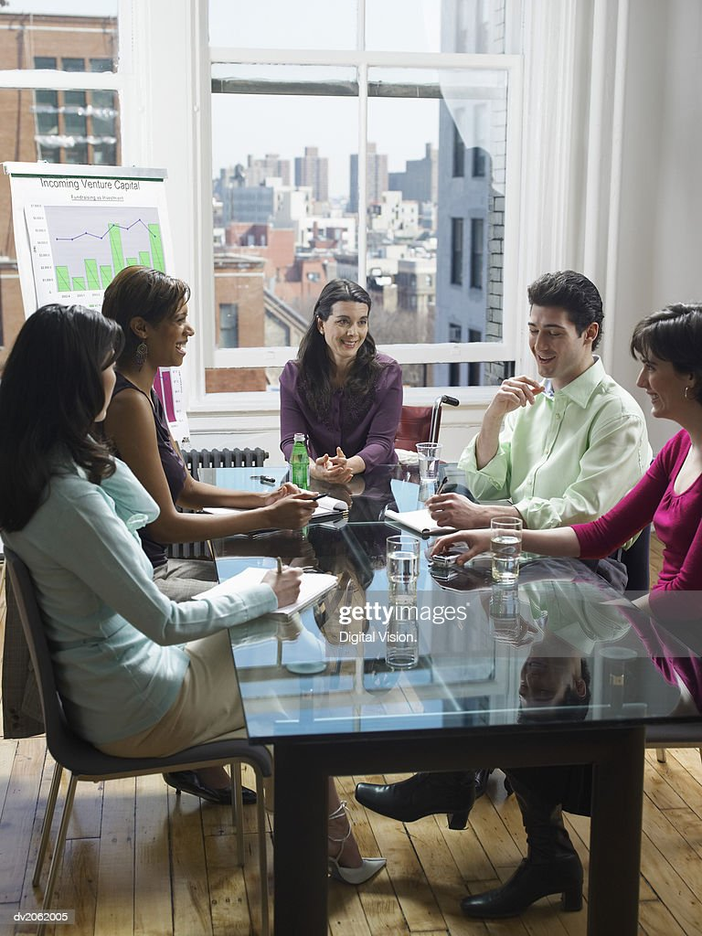 Five Business People in a Meeting : Stock Photo
