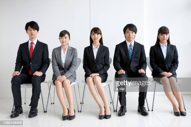 five businessmen sitting in a chair - formal businesswear stock pictures, royalty-free photos & images