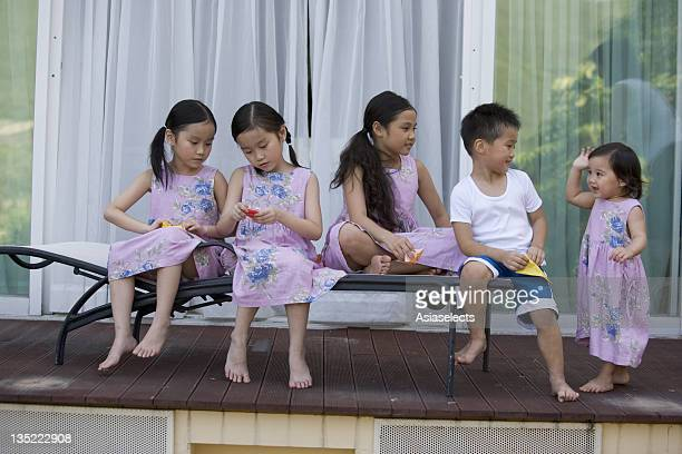 Five children playing together