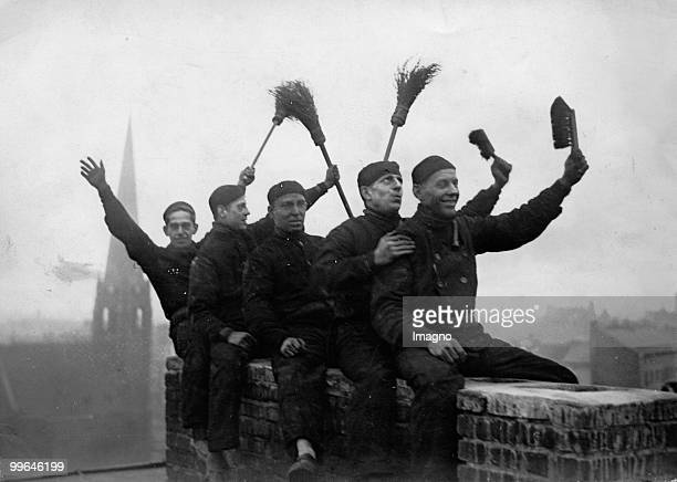Five ChimneySweeper welcoming the New Year Photograph Around 1920