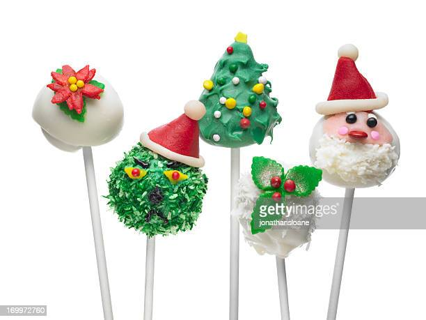 five christmas themed cake pops on sticks - christmas cake stock photos and pictures