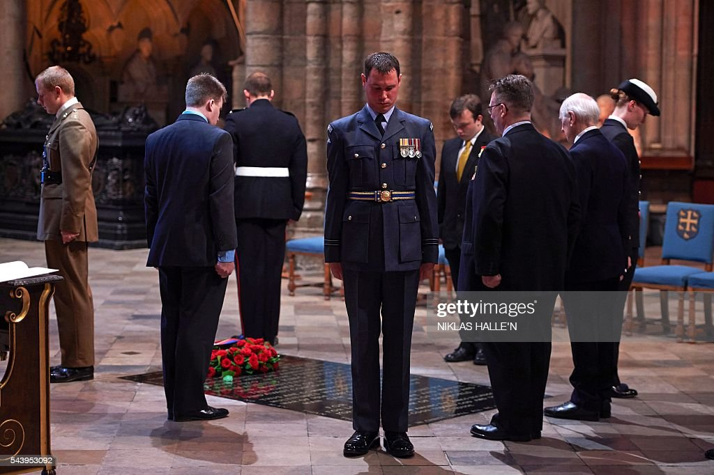 Five civilians and five members of the military form The First Watch, undertaking a Vigil at Grave of the Unknown Warrior after the Service on the Eve of the Centenary of the Battle of the Somme at Westminster Abbey in London on June 30, 2016. Westminster Abbey is holding a Service on the Eve of the Centenary on June 30 2016, and an Overnight Vigil the first time the Abbey has been open all night for a vigil since peace vigils for the Cuban Missile Crisis over fifty years ago. The Abbey service and vigil are part of a programme of centenary events which includes vigils in Scotland, Wales and Northern Ireland, and at Thiepval, Northern France. / AFP / POOL / Niklas HALLE'N